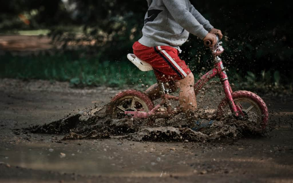 Bike through a mud puddle